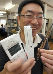 Fukushima Geiger Counters. Sanwa Corporation's President Yuichiro Saito shows the newly developed Geiger counter models. (Mainichi)