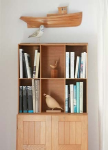A bookcase in the Adamses' living room. Photo by Joshua Chuang
