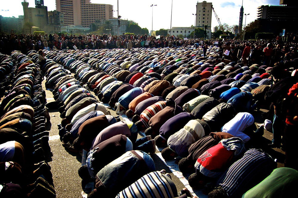 Protesters pray in Cairo's Tahrir Square
