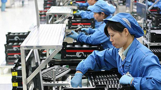 Workers at a hardware factory in China