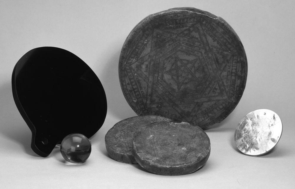 The Seal of Aemeth, two smaller seals, Dee's obsidian disc, his crystal ball, and a golden talisman