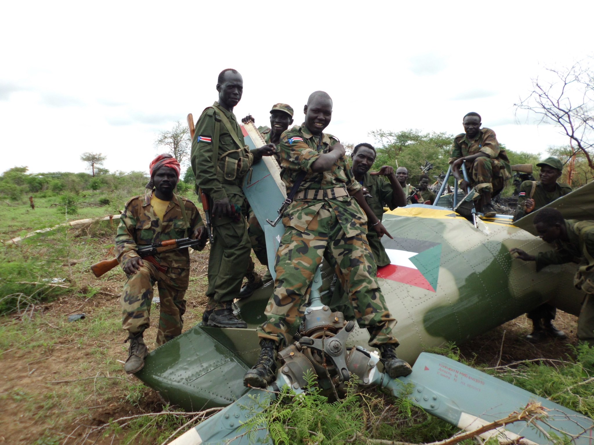 SPLA fighters posing with a downed fighter jet