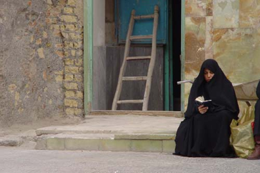 Woman reading in Iran