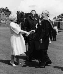 The Queen Mother meeting a headmaster (Donald Lindsey) with her friend Wheeler-Bennett