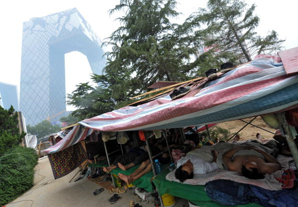 Chinese workers take a nap in their make